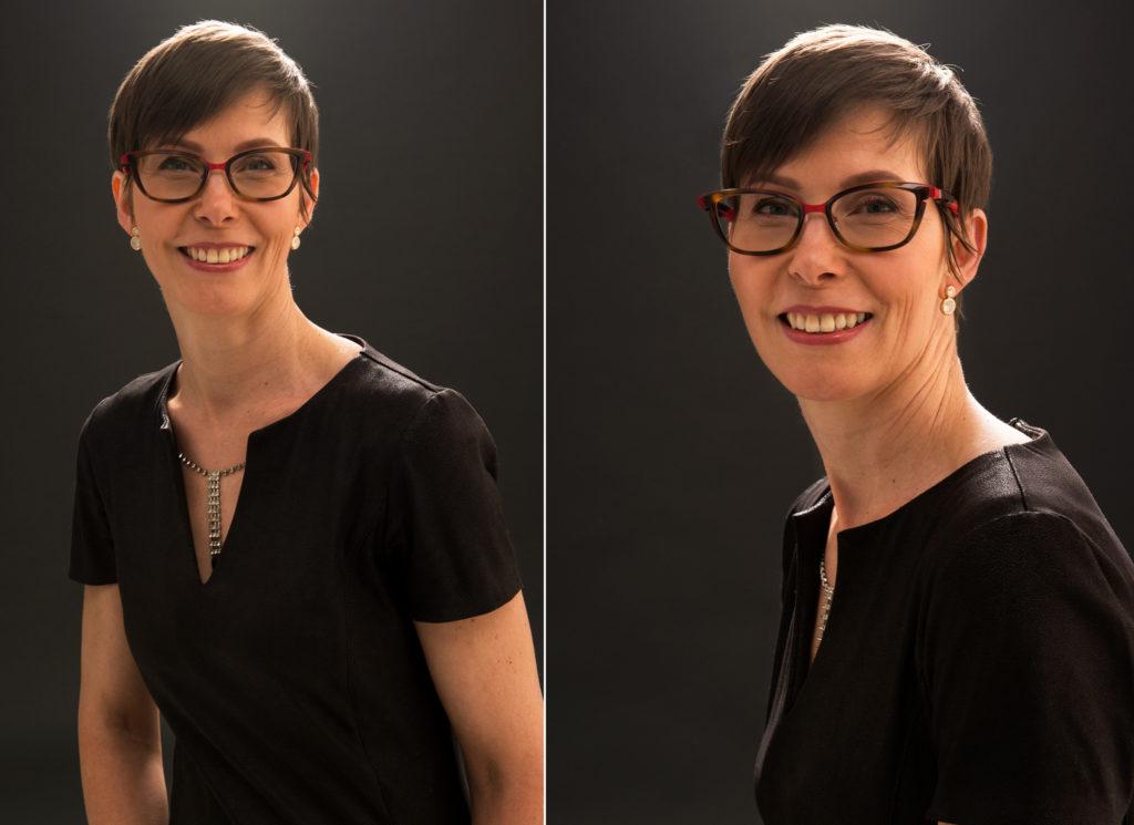 portrait de femme en robe noire sur fond noir en studio