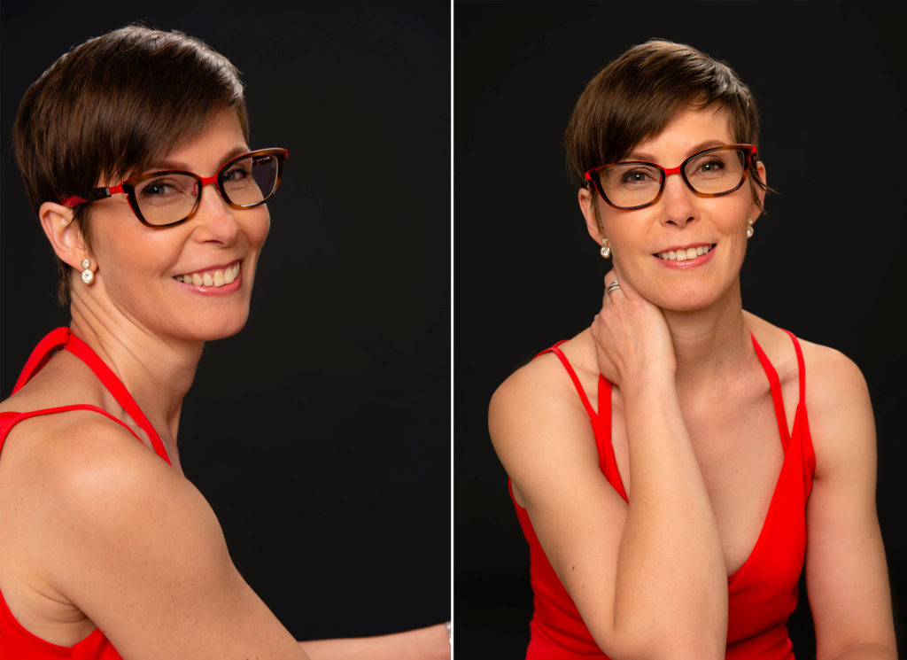 portrait de femme portant une robe rouge sur fond noir en studio